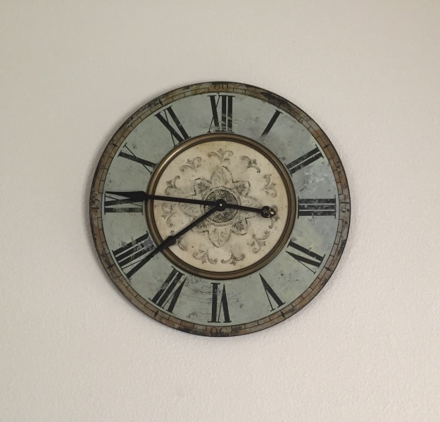 This antique clock is the one purchase I've made for the walls of our house.